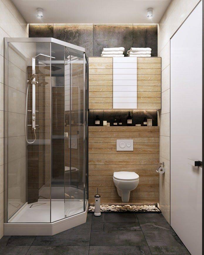 Маленькая ванная комната с душевой кабиной, перегородкой из стекла, стиральной машиной и туалетом: дизайн  - 33 фото