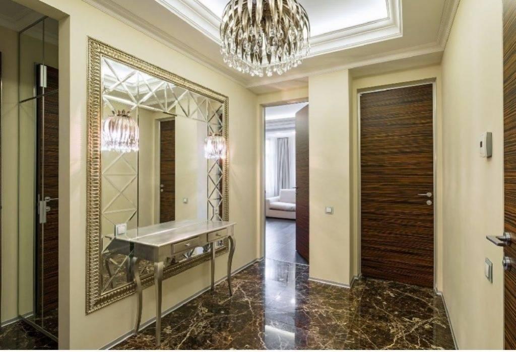 Зеркала в интерьере гостиной, прихожей: идеи оформления большого зеркала на стене, композиции - 44 фото