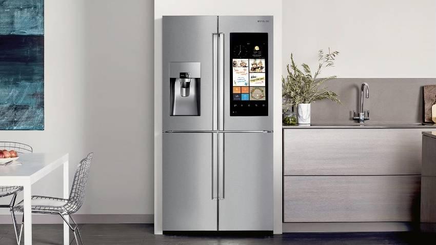 Холодильник в интерьере кухни — куда поставить