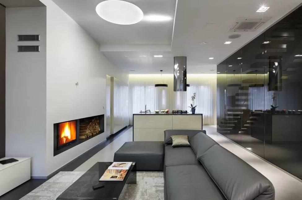 Камин в интерьере гостиной: 99 фото в современном стиле