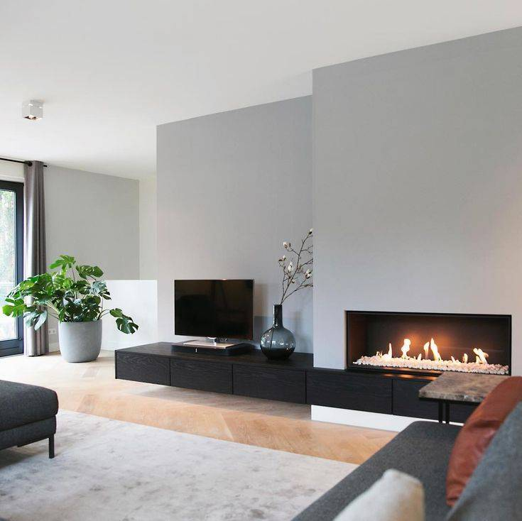 Гостиная с камином — подробный обзор реальных примеров оформления и размещения в гостиной камина